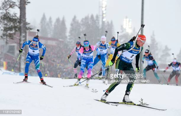 Italy's Dorothea Wierer , Russia's Ekaterina Yurlova-Percht and Germany's Denise Herrmann compete in the women's 12,5 km mass start event at the IBU...