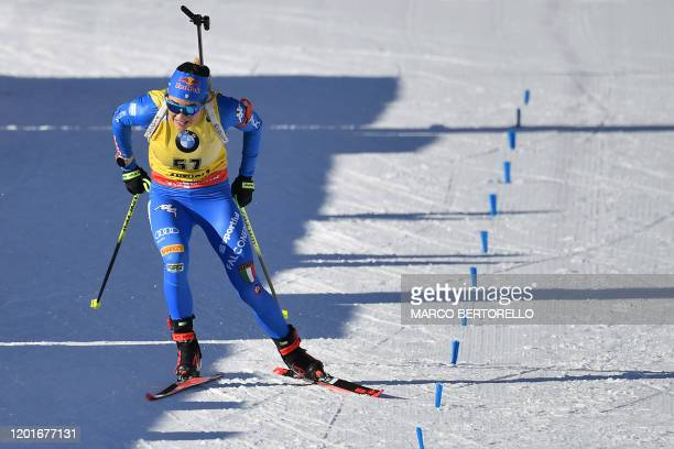 Italy's Dorothea Wierer sprints in the last meters of the IBU Biathlon World Cup Women's 15 km Individual Competition in RasenAntholz Italian Alps on...