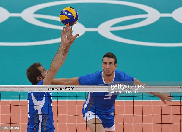 Italy's Dragan Travica sets the ball for teammate Simone Parodi during the men's volleyball bronze medal match of the London 2012 Olympics Games...