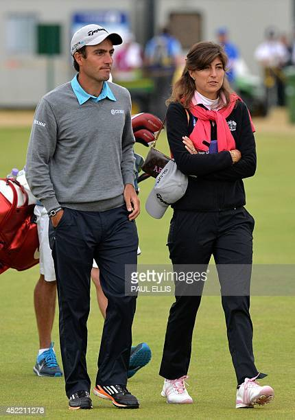 Italy's Edoardo Molinari walks with his wife Anna Roscio during a practice round at Royal Liverpool Golf Course in Hoylake north west England on July...