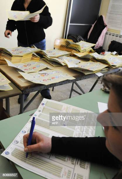 Italy's electoral commission workers conduct the counting of votes in the general elections at a polling station in Naples on April 14 2008 Exit...