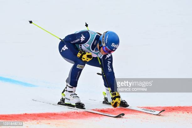 Italy's Elena Curtoni crosses the finish line after competing in the second run of the Women's Giant Slalom event during the FIS Alpine ski World Cup...