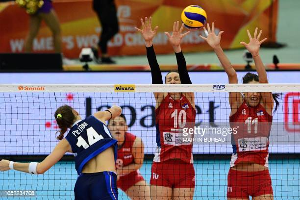 Italy's Elena Pietrini spikes the ball during the 2018 FIVB World Championship volleyball women's pool G match between Italy and Serbia in Nagoya on...