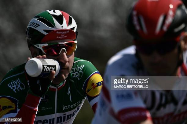 Italy's Elia Viviani drinks during the oneday classic cycling race Milan San Remo on March 23 2019