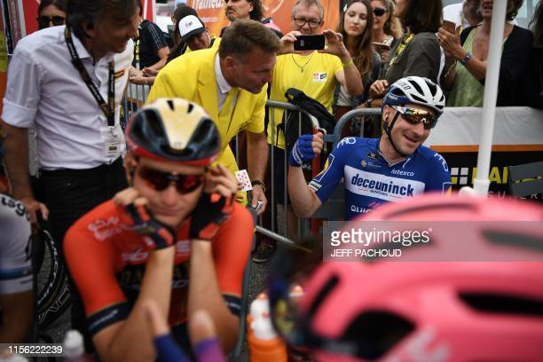 Italy's Elia Viviani reacts as a magician performs a trick before the start of the twelfth stage of the 106th edition of the Tour de France cycling...