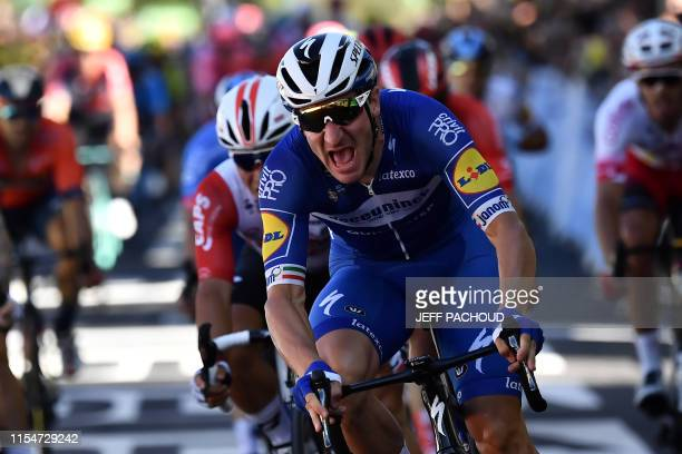 Italy's Elia Viviani reacts as he crosses the finish line at the end of the fourth stage of the 106th edition of the Tour de France cycling race...