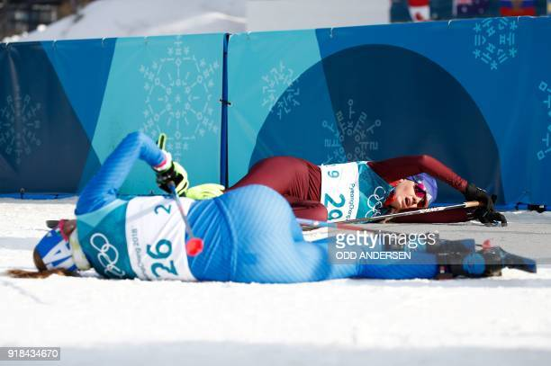 TOPSHOT Italy's Elisa Brocard and Russia's Anna Nechaevskaya collapse after crossing the finish line in the women's 10km freestyle crosscountry...