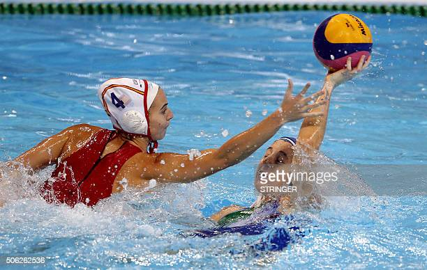 Italy's Elisa Queirolo vies for the ball with Spain's Beatriz Ortiz during the women's water polo bronze medal match between Spain and Italy at the...