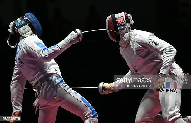 Italy's Enrico Garozzo competes against France's Yannick Borel during the mens team epee gold medal bout between Italy and France as part of the...