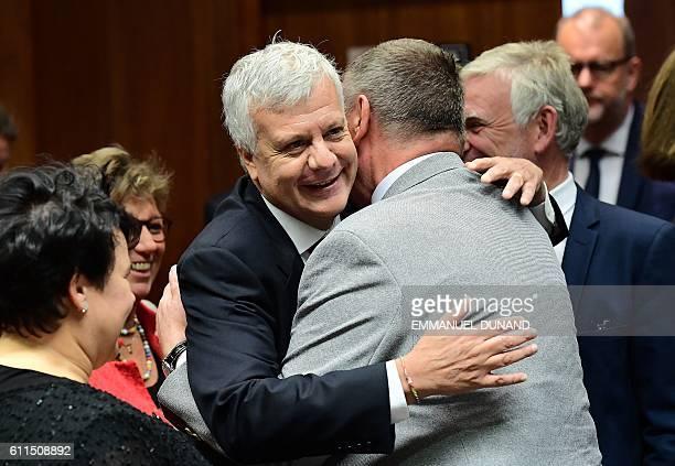 Italy's Environment Minister Gian Luca Galletti hugs Poland's Environment Minister Jan Szyszko during an Environment Council at the European Council...