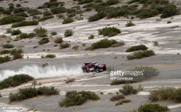 Italy's Eugenio Amos and his co-driver Sebastien Delaunay of France compete during the Stage 10 of the Silk Way 2017 between Hami and Dunhuang,...