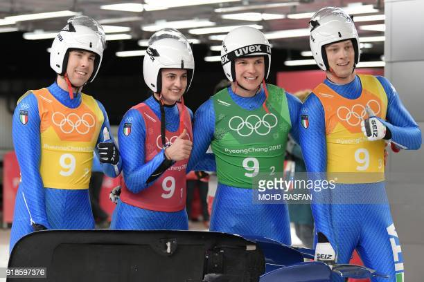 Italy's Fabian Malleier Ivan Nagler Andrea Voetter Dominik Fischnaller celebrate after competing in the team relay competition luge final during the...