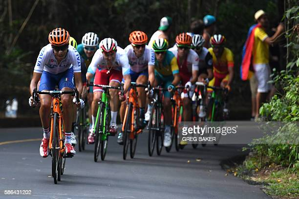 Italy's Fabio Aru leads a chasing group during the Men's Road cycling race in the Rio 2016 Olympic Games in Rio de Janeiro on August 6, 2016. / AFP /...