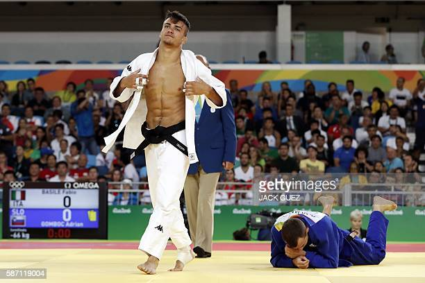 TOPSHOT Italy's Fabio Basile celebrates after defeating Slovenia's Adrian Gomboc during their men's 66kg judo contest semifinal B match of the Rio...