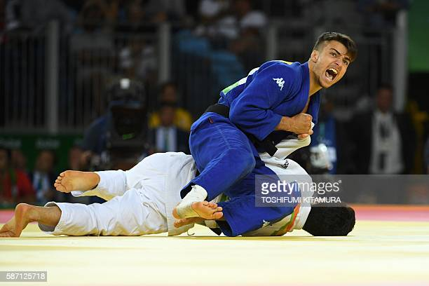 TOPSHOT Italy's Fabio Basile celebrates after defeating South Korea's An Baul during their men's 66kg judo contest gold medal match of the Rio 2016...