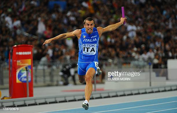 Italy's Fabio Cerutti competes in the men's 4x100 metres relay heats at the International Association of Athletics Federations World Championships in...