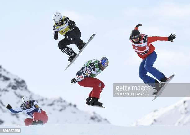 TOPSHOT Italy's Fabio Corbi Spain's Regino Hernandez US snowboarder Nate Holland and Australia's Alex Pullin compete in the FIS Snowboard Cross Women...