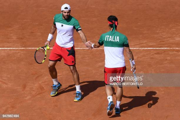 Italy's Fabio Fognini and Italy's Simone Bolelli celebrate a point against France's Nicolas Mahut and France's PierreHugues Herbert during the Davis...
