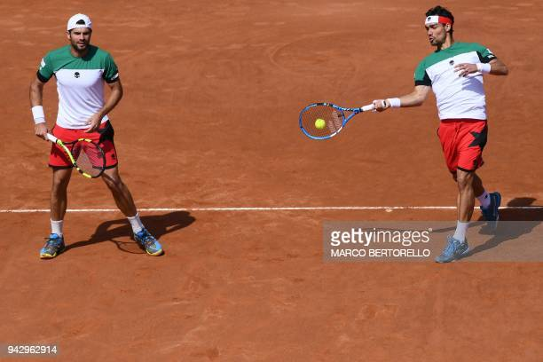 Italy's Fabio Fognini and Italy's Simone Bolelli play against France's Nicolas Mahut and France's PierreHugues Herbert during the Davis Cup...