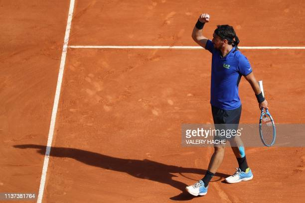Italy's Fabio Fognini celebrates after winning a set against Russia's Andrey Rublev during their tennis match on the day 3 of the MonteCarlo ATP...