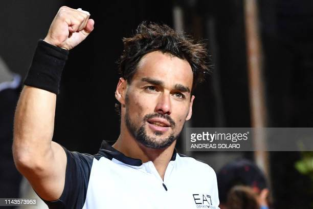 Italy's Fabio Fognini celebrates after winning against France's Jo-Wilfried Tsonga during their ATP Masters tournament tennis match at the Foro...