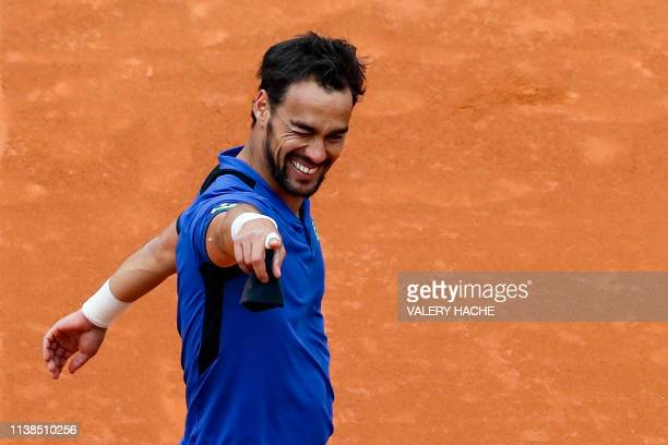 Italy's Fabio Fognini celebrates after winning against Serbia's Dusan Lajovic at the end of the final tennis match of the Monte-Carlo ATP Masters...