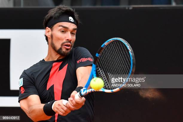 TOPSHOT Italy's Fabio Fognini hits a return to Germany's Peter Gojowczyk during Rome's ATP Tennis Open tournament at the Foro Italico on May 17 2018...