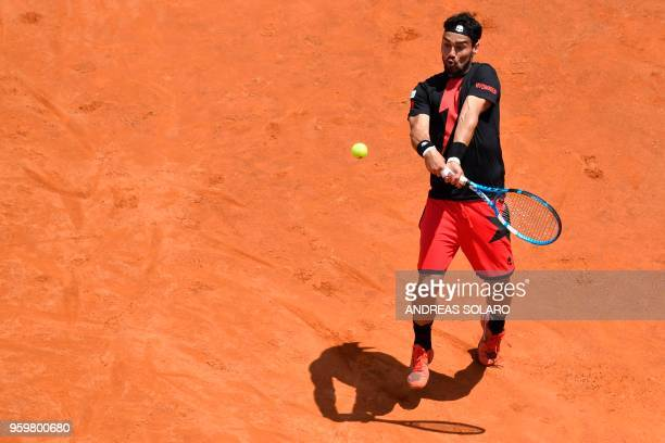 TOPSHOT Italy's Fabio Fognini hits a return to Spain's Rafael Nadal during their quarter final match at Rome's ATP Tennis Open tournament at the Foro...