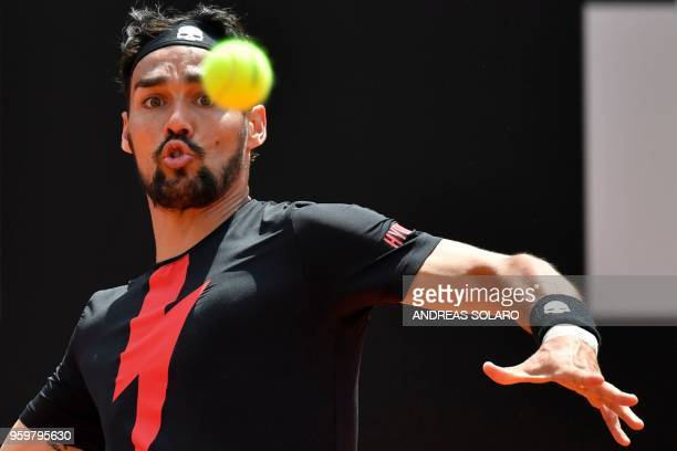 Italy's Fabio Fognini prepares a return to Spain's Rafael Nadal during their quarter final match at Rome's ATP Tennis Open tournament at the Foro...