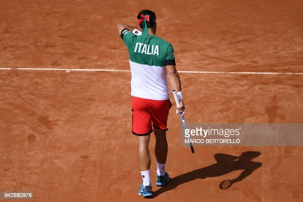 Italy's Fabio Fognini reacts while playing with Italy's Simone Bolelli during the Davis Cup quarterfinal doubles tennis match against France's...