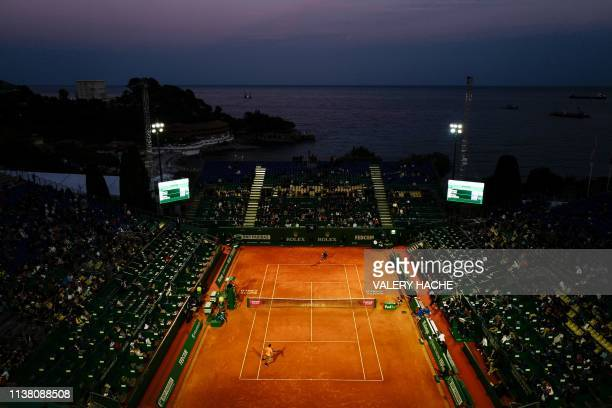 Italy's Fabio Fognini returns the ball to Croatia's Borna Coric during their quarter final tennis match on Day 7 of the Monte-Carlo ATP Masters...