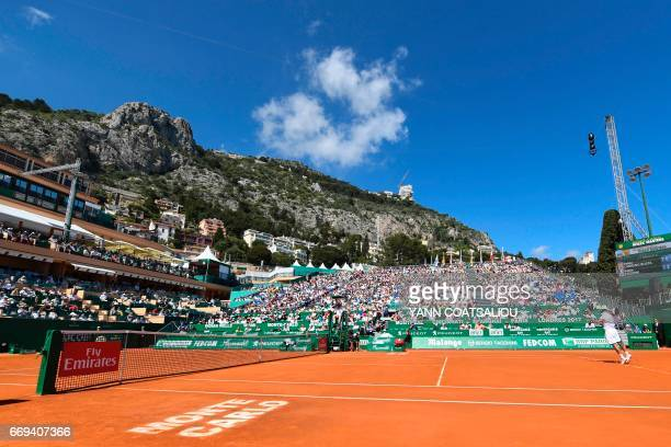 Italy's Fabio Fognini serves to Spain's Pablo Carreno Busta during their tennis match at the MonteCarlo ATP Masters Series tournament on April 17...