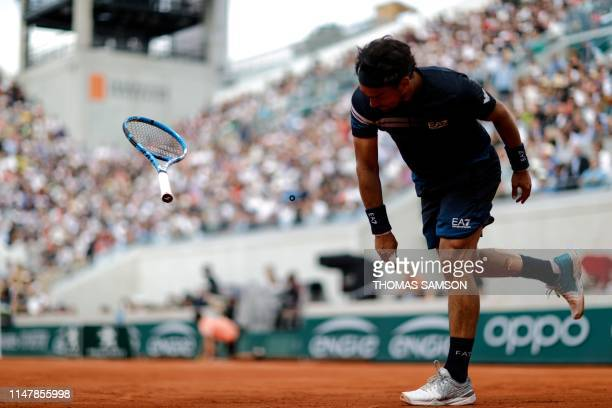 Italy's Fabio Fognini smashes his racquet into the court after a point against Germany's Alexander Zverev during their men's singles fourth round...