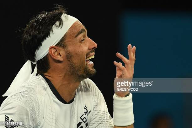 Italy's Fabio Fognini speaks to the umpire during his men's singles match against Argentina's Guido Pella on day five of the Australian Open tennis...