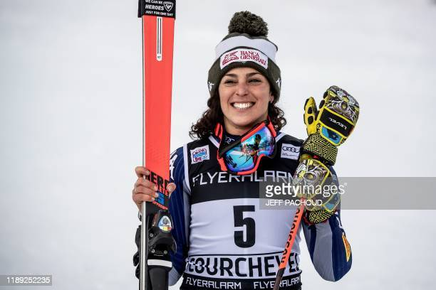Italy's Federica Brignone celebrates after she won the FIS Alpine World Cup Women Giant Slalom on December 17 2019 in Courchevel French Alps