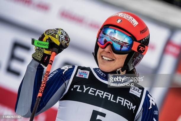 Italy's Federica Brignone celebrates as she crosses the finish line to win the FIS Alpine World Cup Women Giant Slalom on December 17 2019 in...