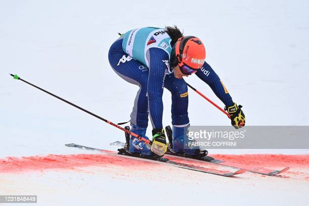 Italy's Federica Brignone crosses the finish line after competing in the second run of the Women's Giant Slalom event during the FIS Alpine ski World...
