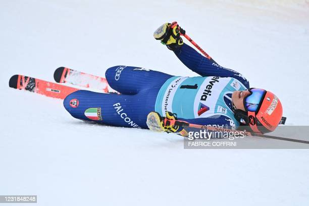 Italy's Federica Brignone lies on the snow in the finishing area after competing in the second run of the Women's Giant Slalom event during the FIS...