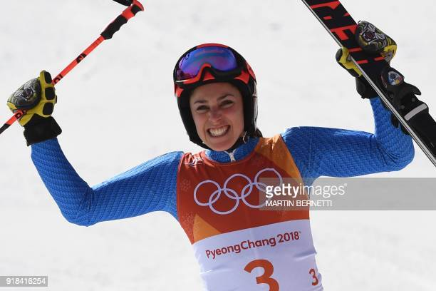 TOPSHOT Italy's Federica Brignone reacts as she crosses the finish line to win bronze in the Women's Giant Slalom at the Yongpyong Alpine Centre...