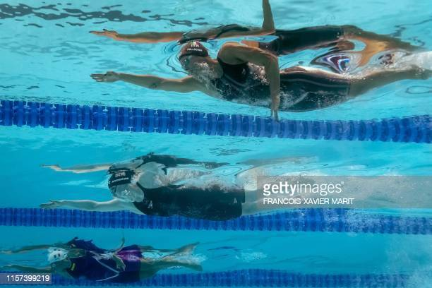 Italy's Federica Pellegrini Britain's Freya Anderson and France's Charlotte Bonnet compete the semifinal of the women's 200m freestyle event during...