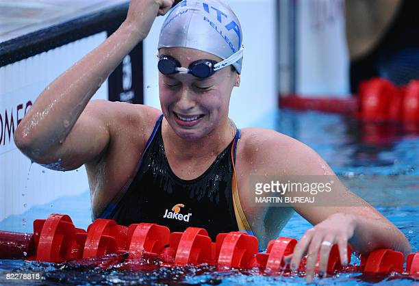 Italy's Federica Pellegrini celebrates after winning the women's 200m freestyle swimming final at the National Aquatics Center during the 2008...