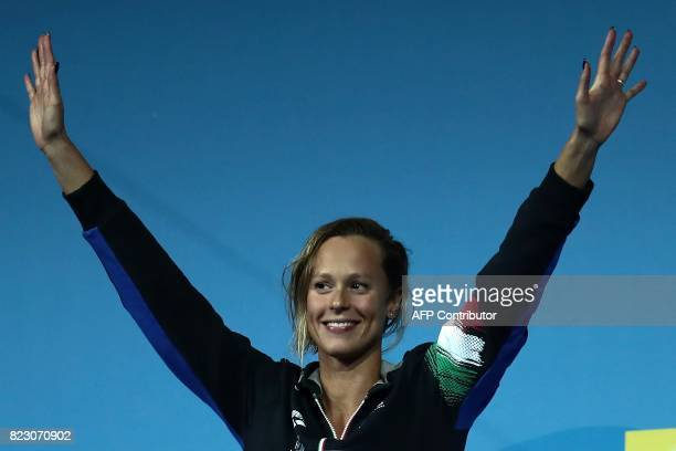 Italy's Federica Pellegrini celebrates winning the gold medal during the podium ceremony for the women's 200m freestyle final during the swimming...