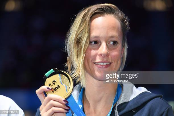 Italy's Federica Pellegrini poses with her gold medal during the podium ceremony for the women's 200m freestyle final during the swimming competition...