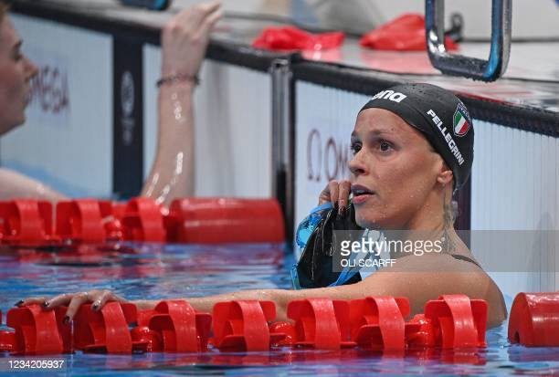 Italy's Federica Pellegrini reacta after a heat for the women's 200m freestyle swimming event during the Tokyo 2020 Olympic Games at the Tokyo...