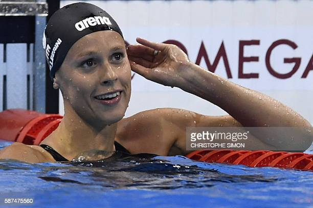Italy's Federica Pellegrini reacts after competing in the Women's 200m Freestyle semifinal during the swimming event at the Rio 2016 Olympic Games at...