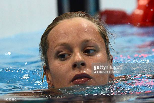 Italy's Federica Pellegrini reacts after the women's 200m freestyle final during the swimming event at the London 2012 Olympic Games on July 31, 2012...