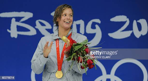 Italy's Federica Pellegrini stands on the podium during the women's 200m freestyle final medal ceremony at the National Aquatics Center during the...