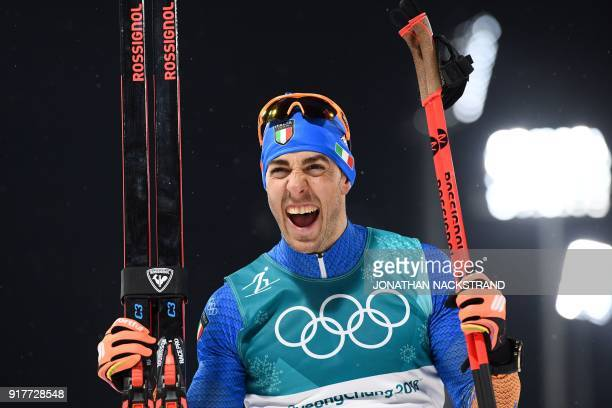Italy's Federico Pellegrino celebrates winning silver in the men's crosscountry individual sprint classic final at the Alpensia cross country ski...
