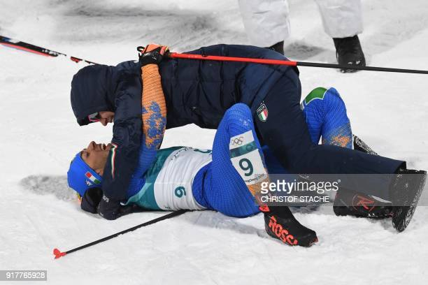 Italy's Federico Pellegrino is congratulated on winning silver after crossing the finish line during the men's crosscountry individual sprint classic...