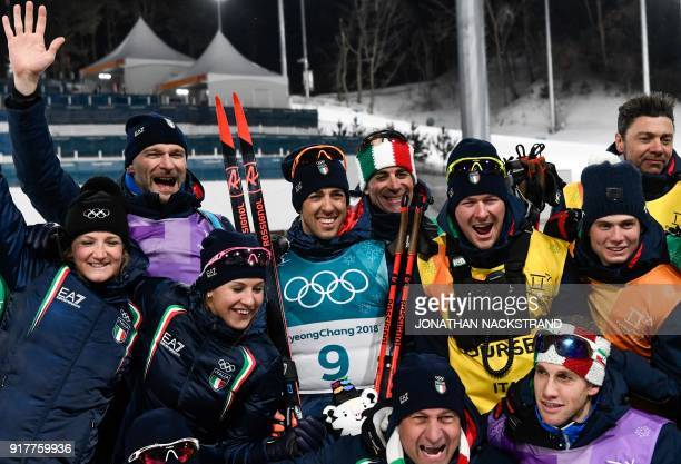 Italy's Federico Pellegrino poses with team members after winning silver in the men's crosscountry individual sprint classic final at the Alpensia...